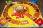 A smart ass game board with spaces to place the cards.