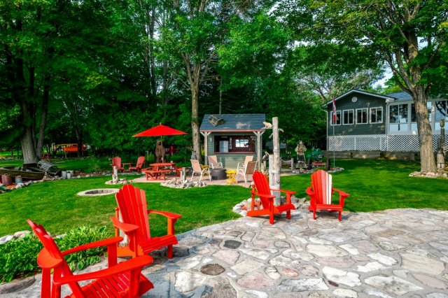 081 26 fire rte 103 bobcaygeon ON stone patio - WATERFRONT ~ 4 SEASON COTTAGE FOR SALE ON PIGEON LAKE