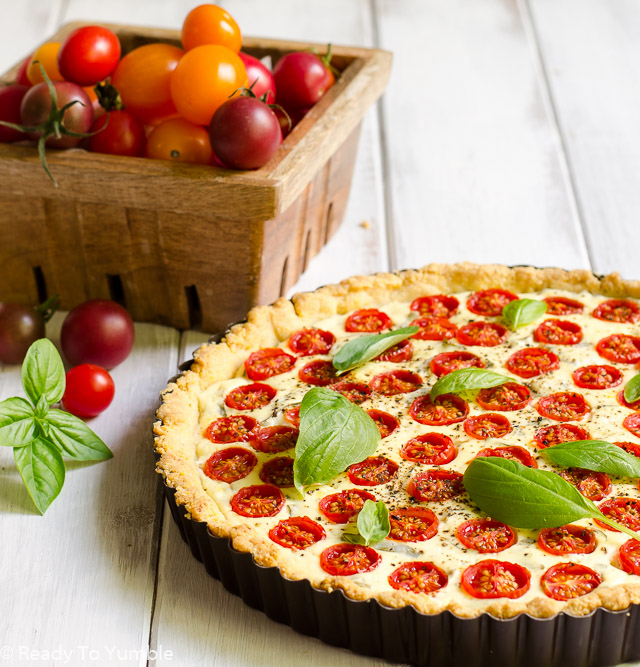 Tomato, Basil, and Goat Cheese Tart combines the perfect savory flavors of the season in a buttery cornmeal crust. Good hot or cold, for breakfast, lunch, or dinner!