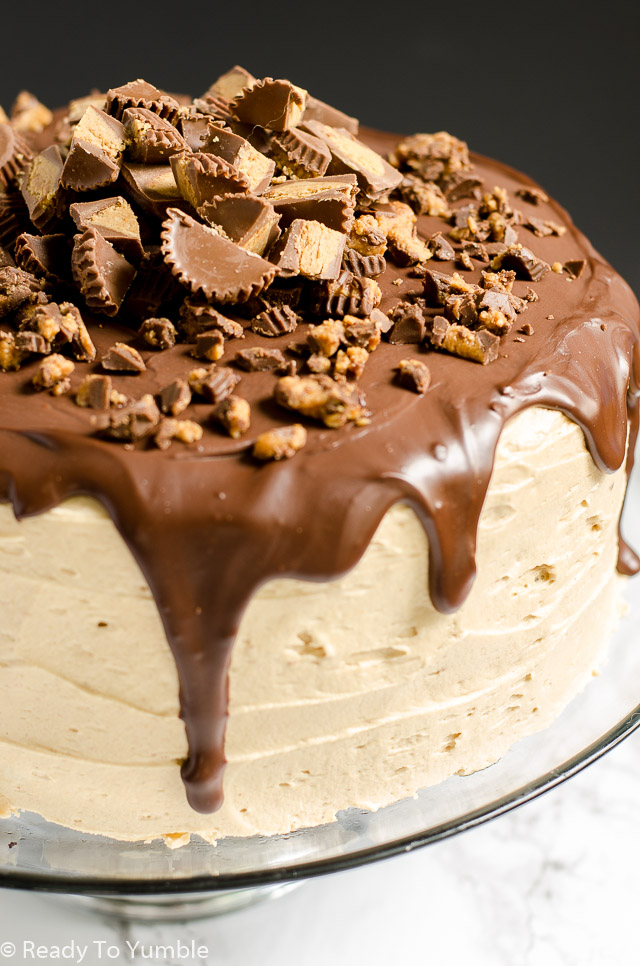 Peanut Butter Bourbon Chocolate Cake combines layers of moist and rich chocolate cake with a craveable peanut butter bourbon frosting. Top the whole thing with ganache and peanut butter cups for the ultimate celebratory dessert!