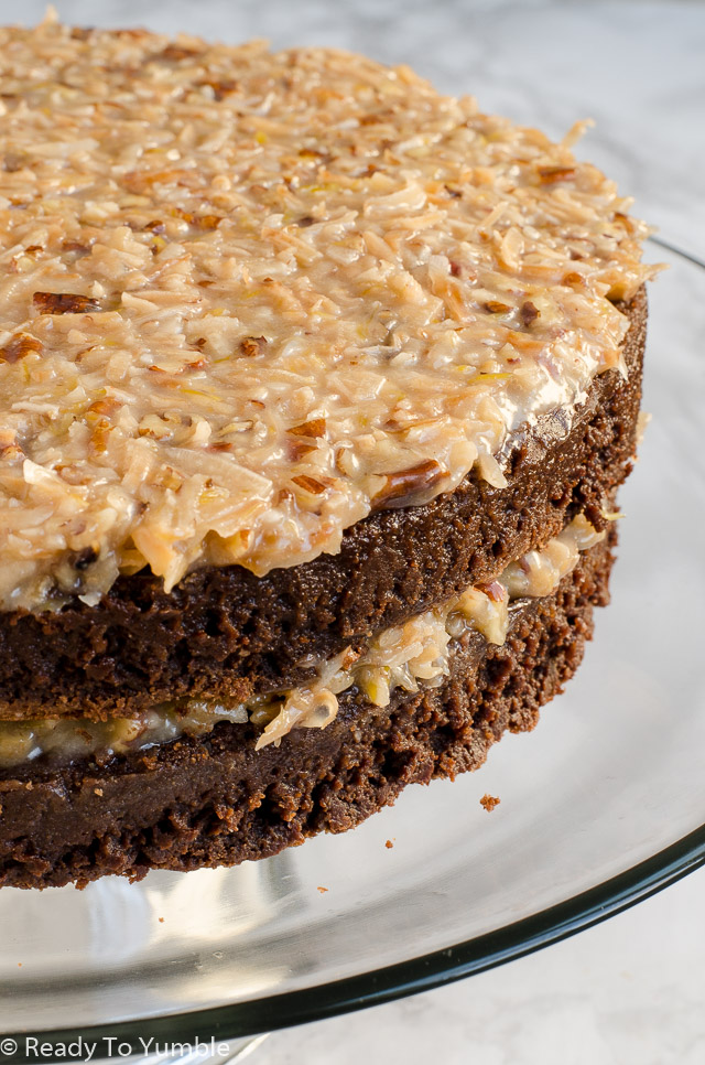 Decadent German Chocolate Cake pairs an intense flourless chocolate cake with coconut and pecan frosting - insanely indulgent and sure to please a crowd!