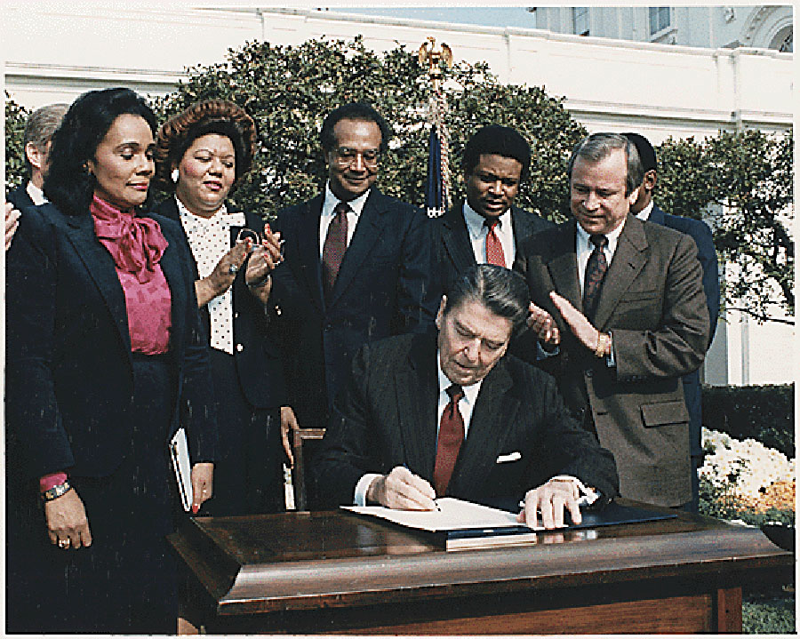 Ronald Reagan and Coretta Scott King at the Martin Luther King, Jr. Day signing ceremony.