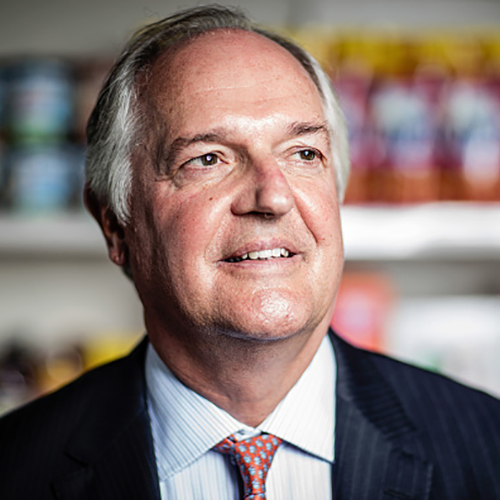 Paul Polman, chief executive officer of Unilever NV, poses for a photograph with a selection of Unilever products at their headquarters in London, U.K., on Wednesday, Aug. 24, 2016. Unilever manufactures branded and packaged consumer goods, including food, detergents, fragrances, home, and personal care products. Photographer: Simon Dawson/Bloomberg via Getty Images