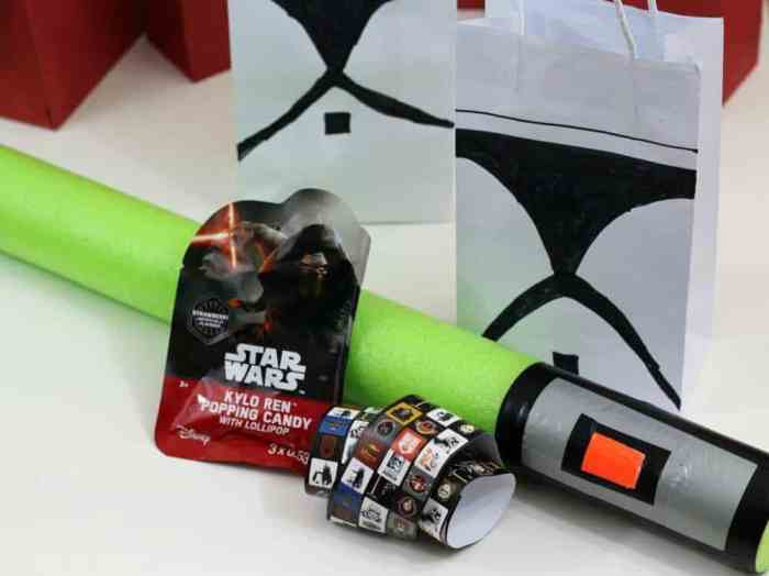 Star Wars Party favors include candy, stickers, and a pool noodle light saber