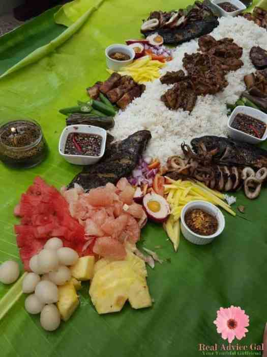 Boodle fight in the Philippines using banana leaves