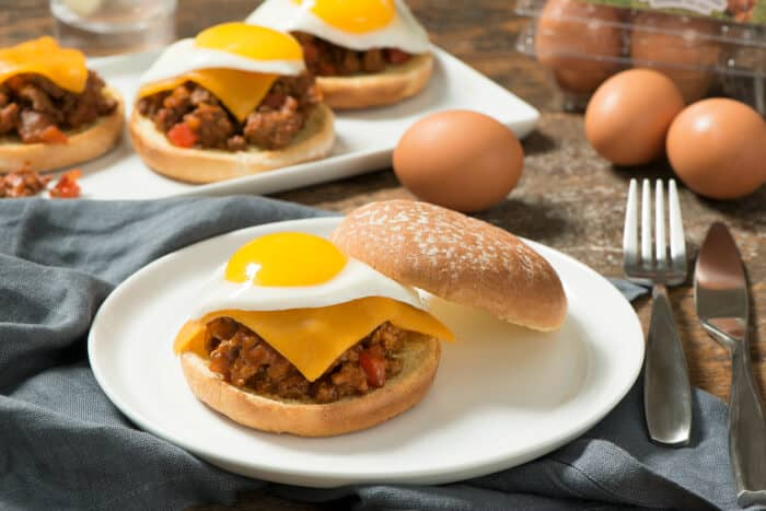 This Smoky Sloppy Joes with Fried Eggs is a hearty sandwich seasoned with smoked paprika, then topped with cheese and a fried egg.