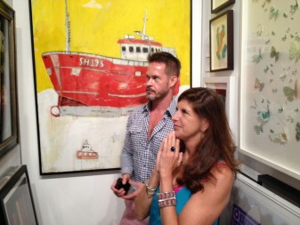 Admiring the work of Klaus Enrique  at the Art Hamptons show in front of Rob Tucker's    mixed media ship work - oil / resin on board.