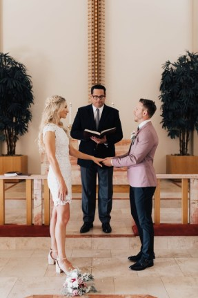 Darcie and Logan exchanging vows St. Paul's church San Diego
