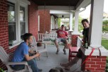 Jamie Long, Ben Trumbo, Tim Brady in a front porch meeting, complete with brews and dogs