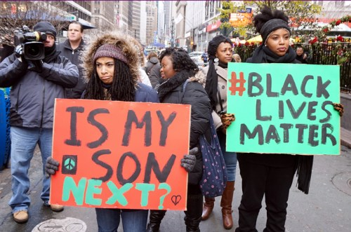 NYC action in solidarity with Ferguson. Mo, encouraging a boycott of Black Friday Consumerism.