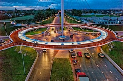 Source: http://www.reddit.com/r/pics/comments/1p97m6/the_hovenring_is_a_suspended_bicycle_path/