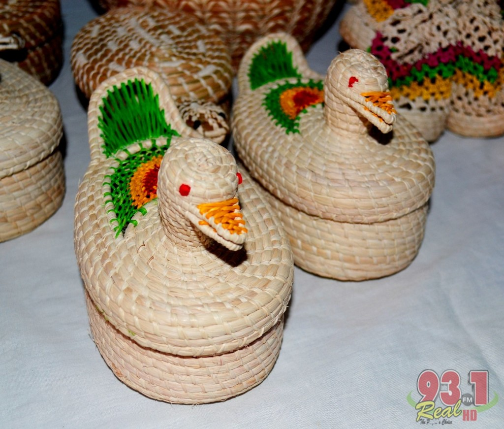 Many beautiful hand -crafted ornaments are on sale at the Heritage Village .