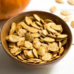 This recipe for savory roasted pumpkin seeds makes a healthy, frugal, vegan snack. Pumpkin seeds are easy to roast in the oven, so don't throw them away!