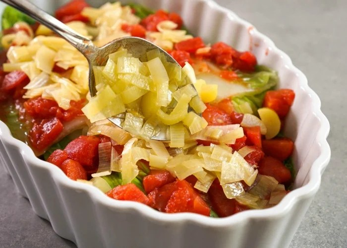 Leeks are layered in the cabbage casserole.