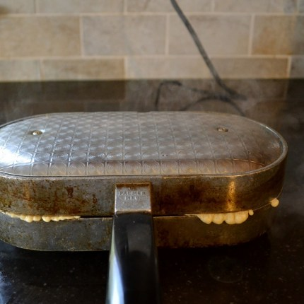 Pizzelle maker in action for waffle cone bowl recipe