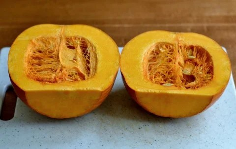 Cut the pumpkin in half.