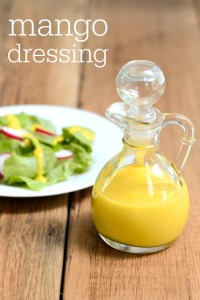 This mango salad dressing recipe is a delicious topping for greens, chicken, or fish. It's a sweet dressing that keeps in the fridge for several days. Recipe from realfoodrealdeals.com