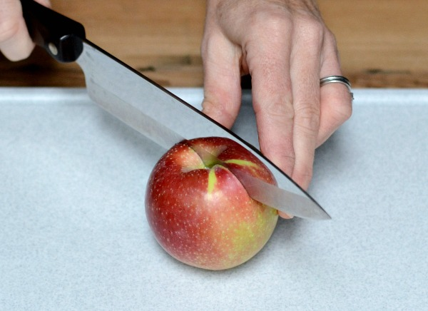 Cutting apple with chef knife
