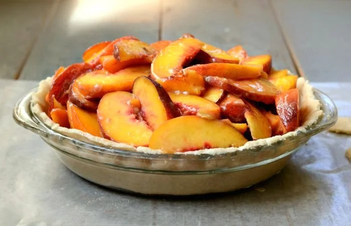 I like to pile the peaches high in my peach pie recipe.