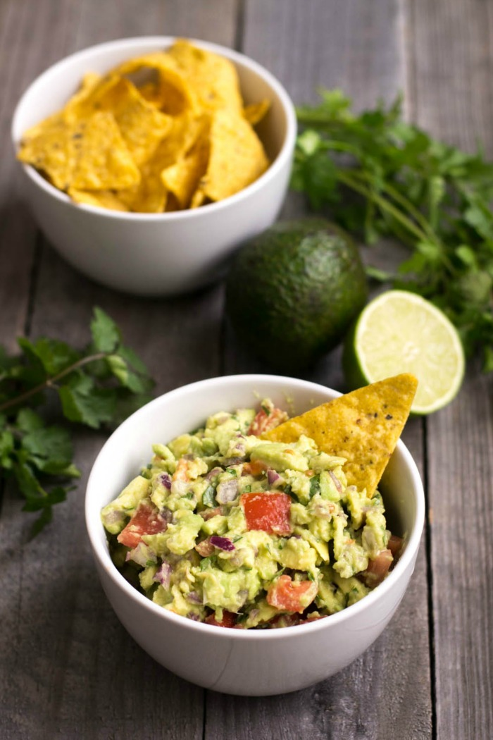 People will gather around this healthy guacamole recipe at your next party. This delicious, filling appetizer is addictive even though it's super healthy! The only guac recipe you'll ever need.