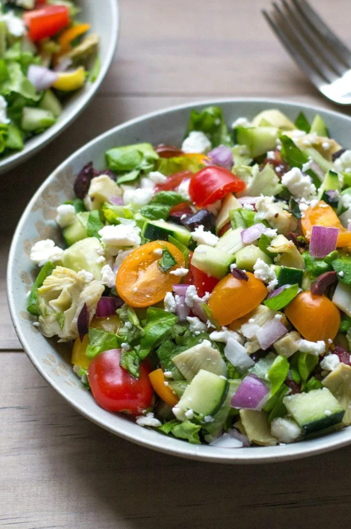 This chopped Greek salad recipe is a delicious meatless meal or side dish. It's full of fresh vegetables and just the right amount of savory goodness.