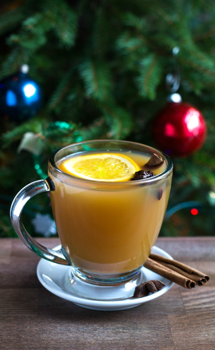 This mulled cider is such a delicious, festive treat to enjoy at a holiday party. It's also great for when you're decorating your tree. Recipe from realfoodrealdeals.com