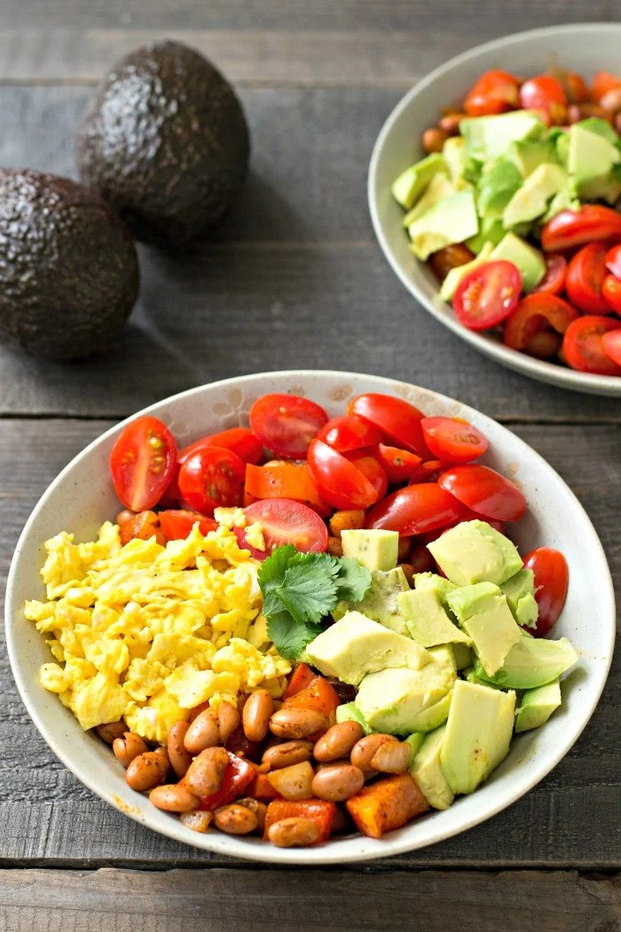 This Avocado Breakfast Burrito Bowl is a delicious and nourishing way to start your day. Try this easy recipe for a fun twist on the classic breakfast burrito. Recipe from realfoodrealdeals.com