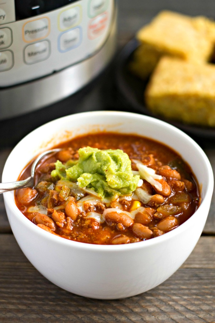 This 10 minute Instant Pot beef chili is such an easy, healthy dinner recipe. The flavor is pure comfort food, and it tastes like it's been simmering all day.