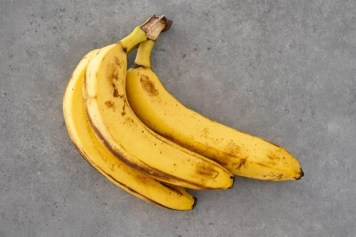 Ripe bananas with brown spots