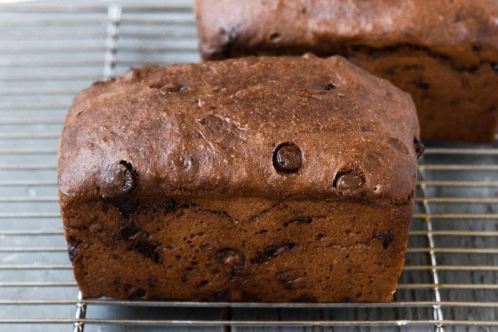 This double chocolate banana bread is cooling on a wire rack.