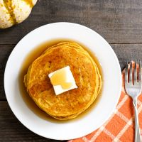 Pumpkin pancakes on a plate from above