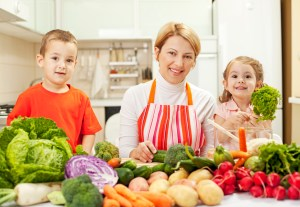 family-in-kitchen-300x207 10 Tips To Raise Fit Kids Who Like To Eat REAL Healthy food!
