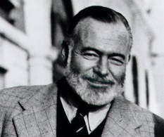 """**FILE** Ernest Hemingway stands on the Bridge of Sighs in Venice, Italy, in this 1950 file photo taken by his friend Aaron Edward Hotchner and released by the Library of Congress. Singing a takeoff of Johnny Cash's """"Folsom Prison Blues"""" helped a Texas commercial property developer win an Hemingway look-alike contest during a festival honoring the author that ended Sunday, July 23, 2006 in Key West, Fla. Sporting a khaki hunting outfit, white beard and bushy eyebrows, Chris Storm, 55, hit Cash-like low notes as he sang a plea for contest judges' votes during the highlight of the six-day Hemingway Days festival. The competition drew 130 other bearded entrants who paraded across the stage at Sloppy Joe's Bar, the author's favorite watering hole (AP Photo/Library of Congress, A.E. Hotchner, FILE)"""