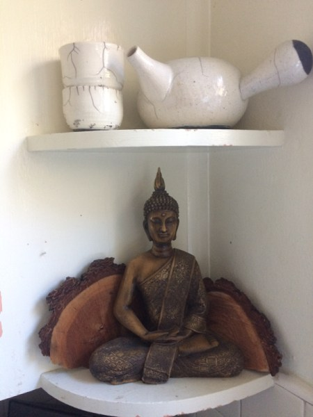 Meditating Buddha with tea service