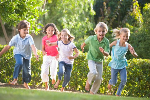 5 kids run happily outside