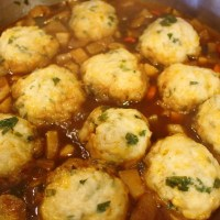 Guinness Beef Stew with Parsnips and Turnips Served with Cheddar Herb Dumplings