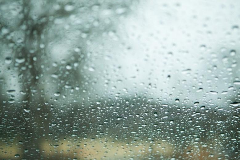 rain on the window for a rainy wedding day photo