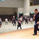 Ex-Olympic Athletes Stretch Lecture at Evacuation Centre