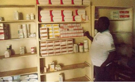 Senior Clinical Officer, Simon Opido, receiving RMF/WCF supplies at Panyadoli Health Centre III