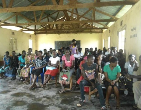 New students listen attentively to the remarks of the coordinator