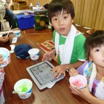 children enjoy donated iPad