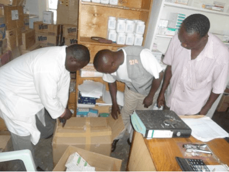 medicines and medical supplies are unpacked at the Panyadoli Health Centre