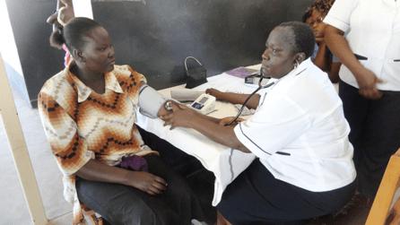 patient having her blood pressure taken