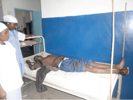Musa Alhaji lays in bed after being rushed to the clinic