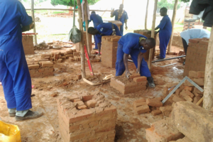 vocational students laying brick