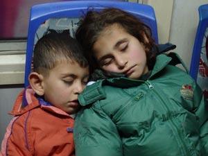children sleeping on train
