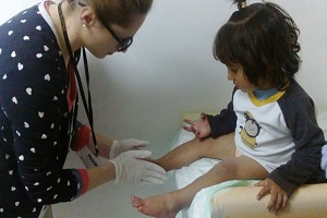 doctor giving care to small girl