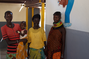 kenyan women standing with young child