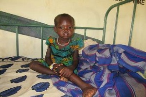 young girl sitting in hospital bed