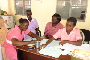 JCONAM midwifery students reviewing and enrolling women for antenatal care services